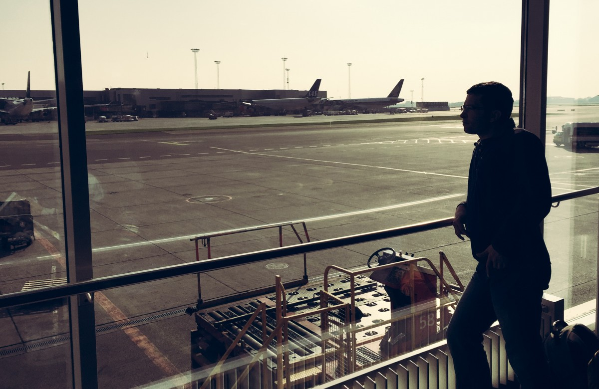 Daniel looking out of the airport window