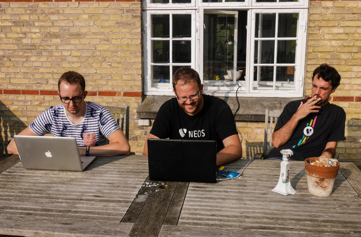 3 Neos developers at work